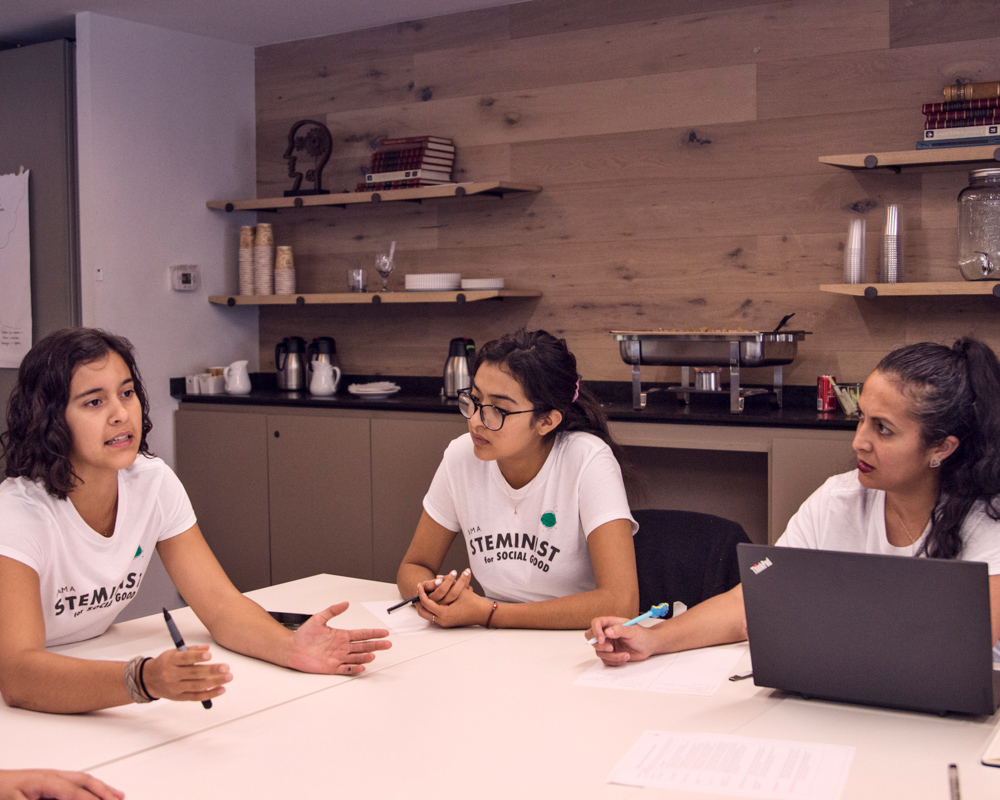 Group of girls discussing STEM
