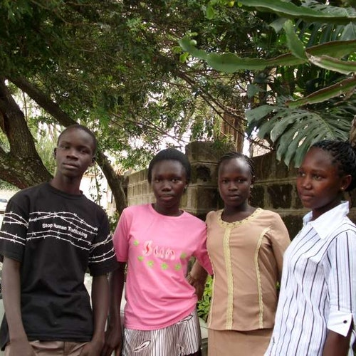 3 girls and 1 boy pose for the picture in Africa