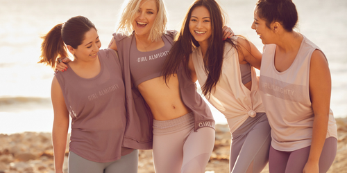 "Kate Hudson with other three girls have big smile on their face and wearing Fabletics has ""girl almighty"" on it"