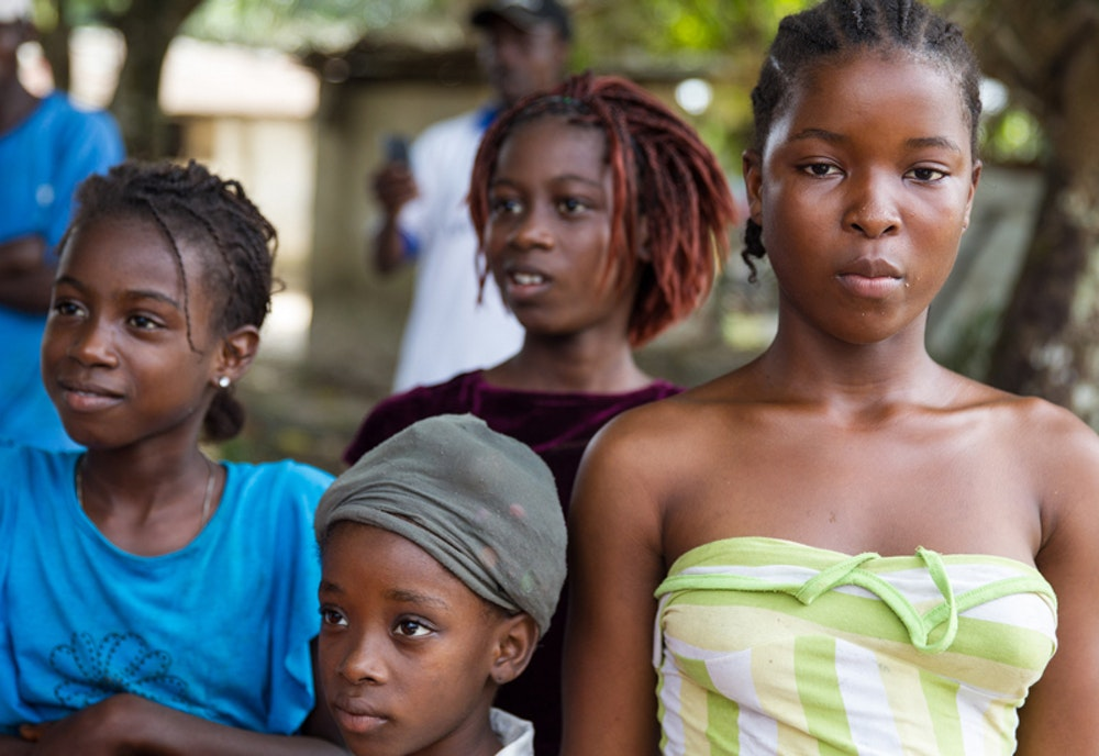 4 girls of different ages and 3 girls showing their side face and one girl face directly to the camera