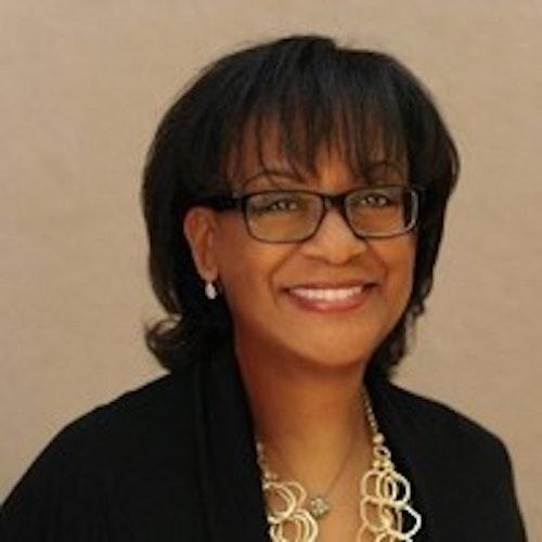 Karen Miller, Conselho Consultivo (foto de perto, desfocada, tendo um plano de fundo mais escuro)