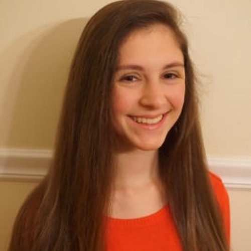 Katrina Sousounis 2016-2017 Teen Advisors ( long angle half-body, blurry pciture) with her smiley face facing the camera