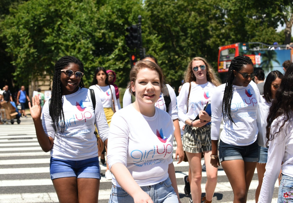 Lauren Teen Advisor crossing the road and smile for the picture