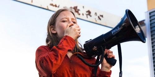 (close angle) Eva Jones 2018-2019 Class Teen Advisors holding a loudspeaker