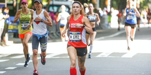 Rebekah Kennedy is running the marathon and she appears ahead of other women runners
