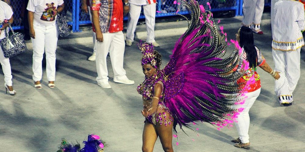 a woman on her feather dress in carnival festivity