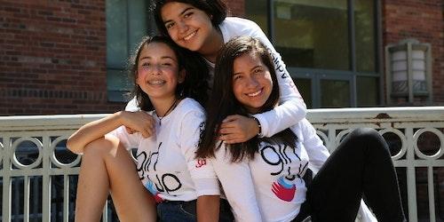 3 girl up girls wearing girl up teen advisor t-shirt