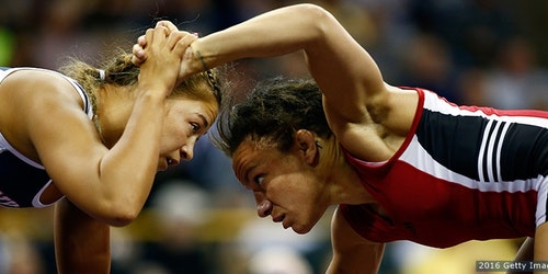(close angle) Campbell Kelsey is wrestling with other athletes