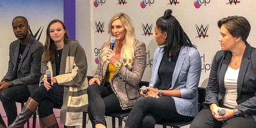 wwe-and-girl-up forum (5 people on the stage) WWE Superstar Charlotte is holding a mic facing to the front