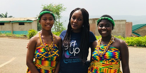 two African Girl Up members (in traditional African clothes) with a Girl Up staff