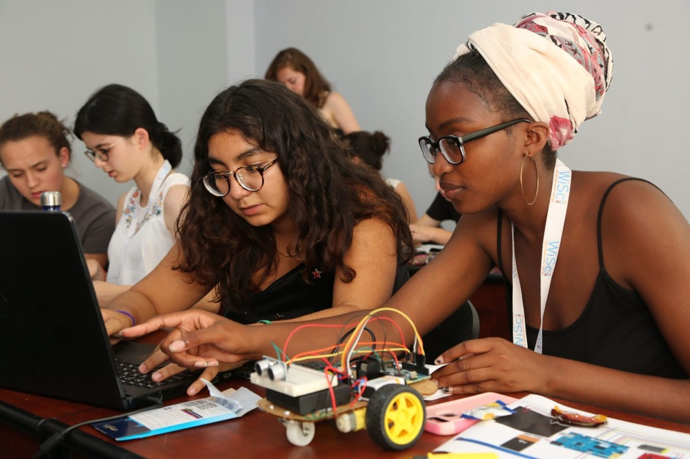 two Girl Up girls working on a STEM project with their computer (WiSci Summit)