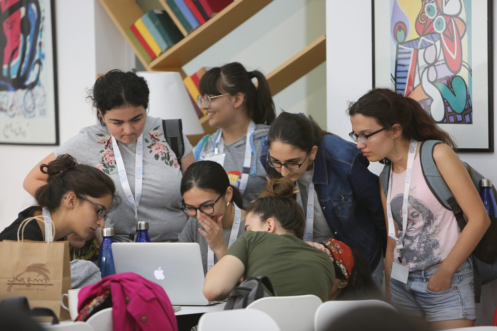WiSci Girls STEAM Camp participants at a computer.